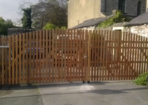 Paled arched top driveway gates