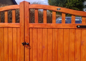 Framed part solid arched top driveway gate