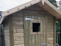 Shed with window in door by Empress Fencing